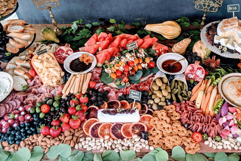 grazing table with fruit cheese and crackers