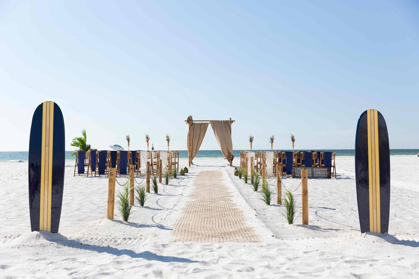 beach wedding ceremony decor surfboards at the entrance to the aisle