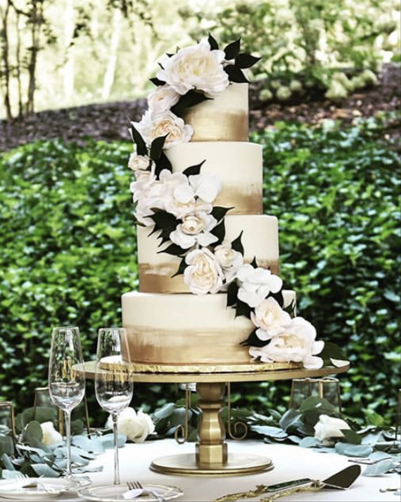 wedding cake with floral garland