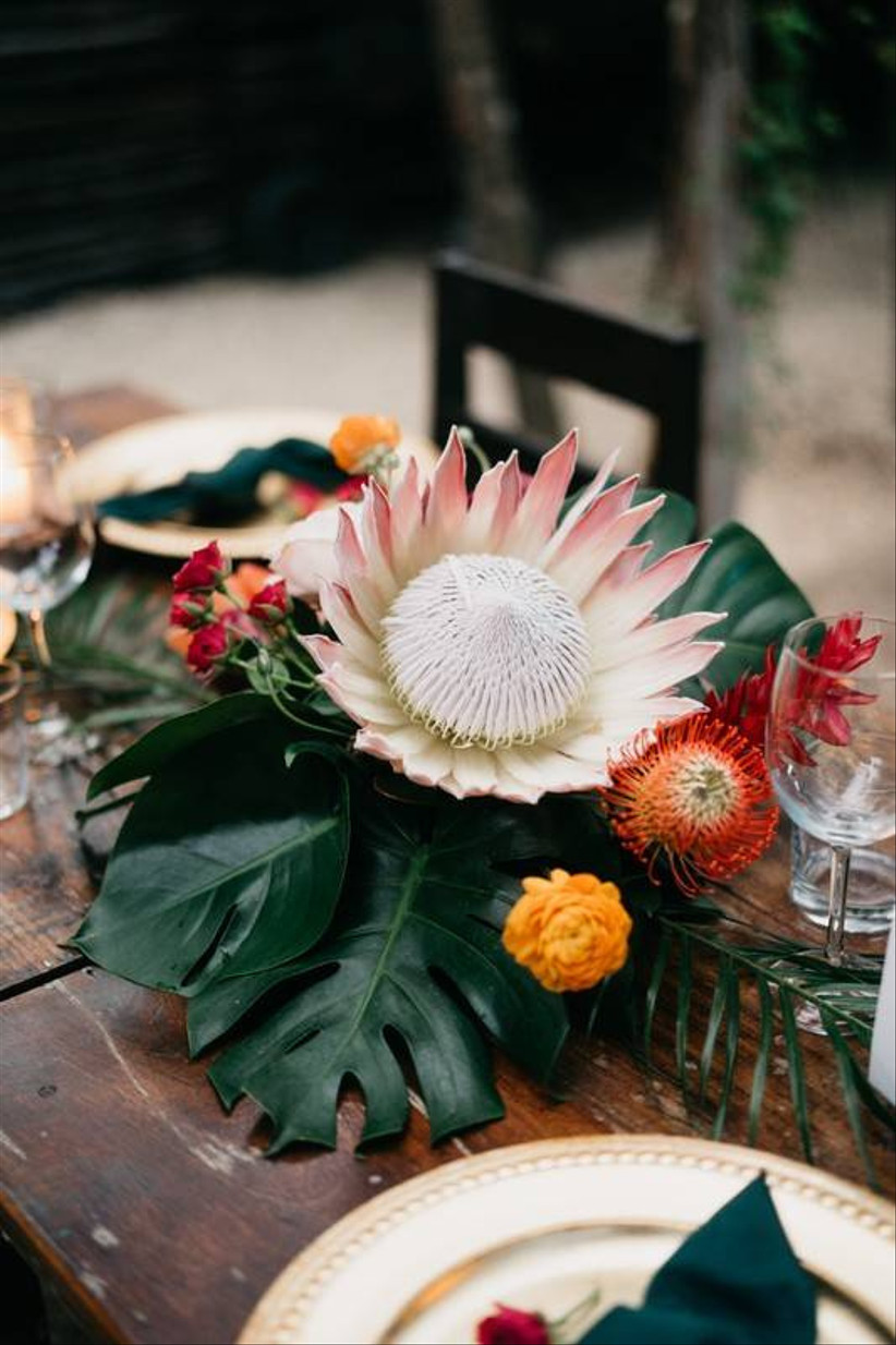 large king protea beach wedding centerpiece with greenery and yellow flowers