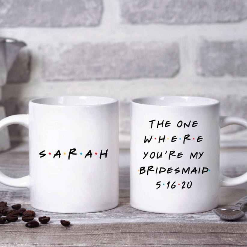 Front and back view of Friends-inspired bridesmaid proposal mug with SARAH on one side and The One Where You're My Bridesmaid on the other