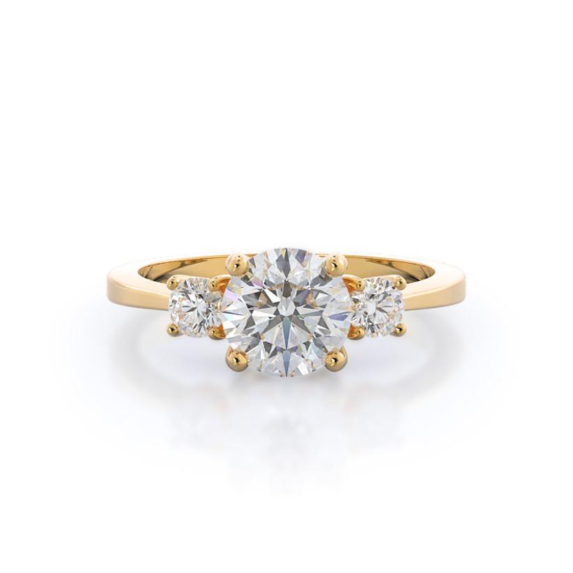 yellow gold three stone engagement ring with round diamonds