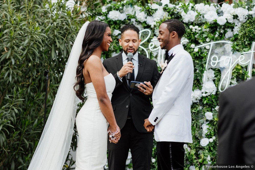 Black bride and groom standing at altar