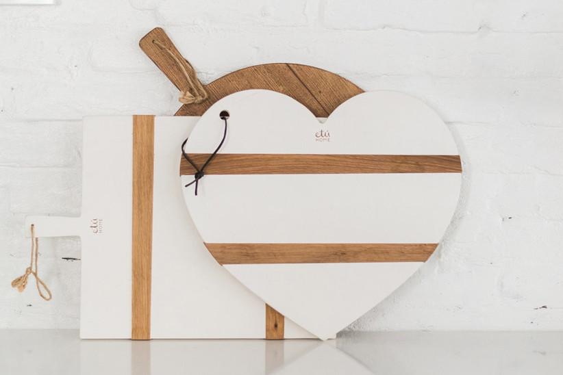 Handmade white and wood-tone heart-shaped charcuterie board