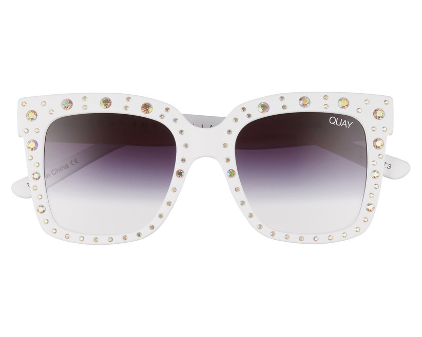 oversized white sunglasses with iridescent rhinestones around the lenses
