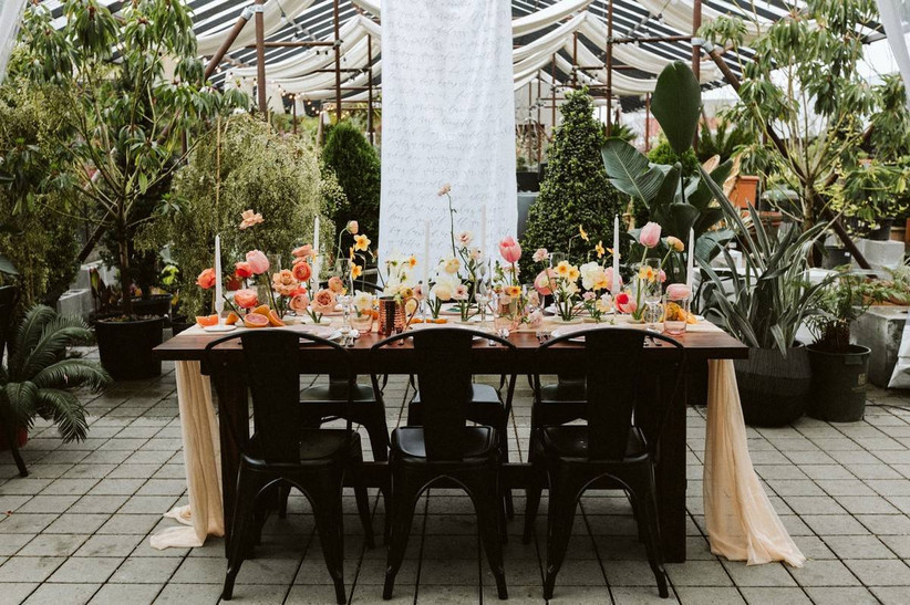 wedding reception table with black metal marais chairs
