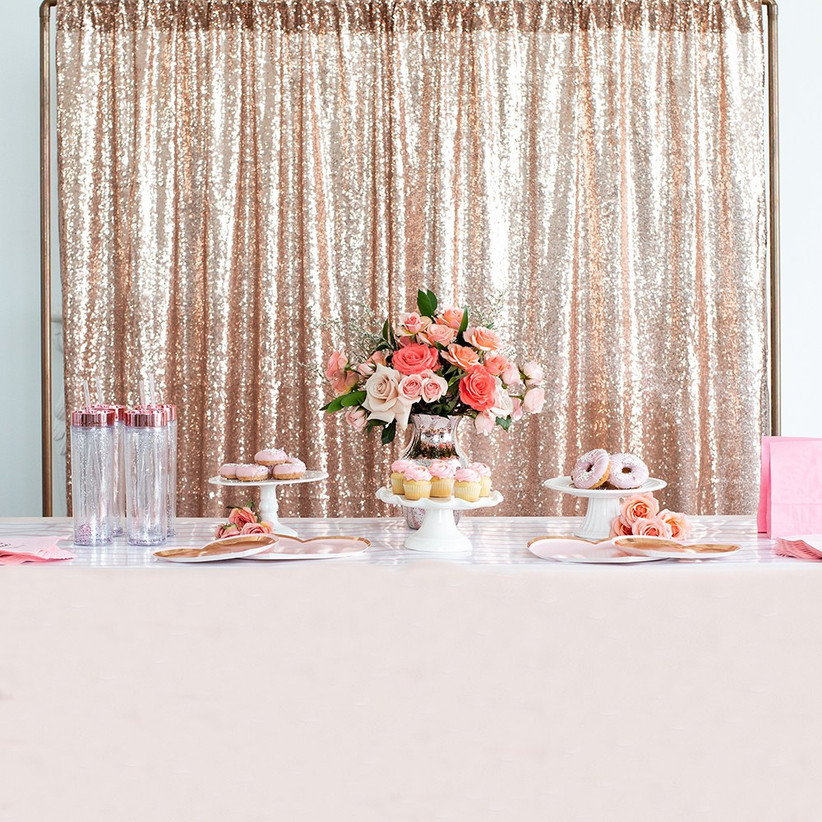 Dessert table with sequin rose gold backdrop