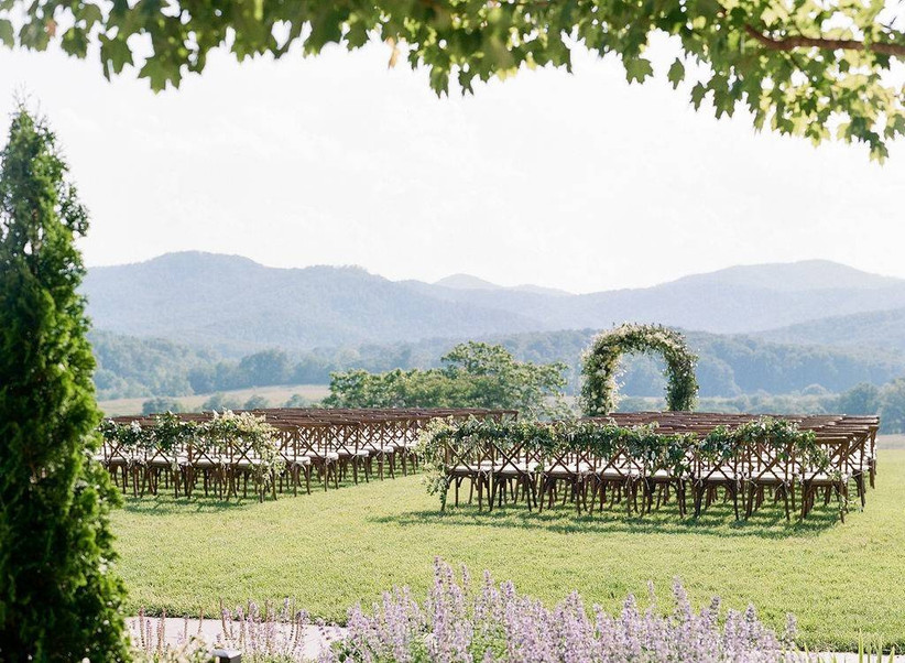 outdoor wedding ceremony at pippin hill farm with mountain views in the distance