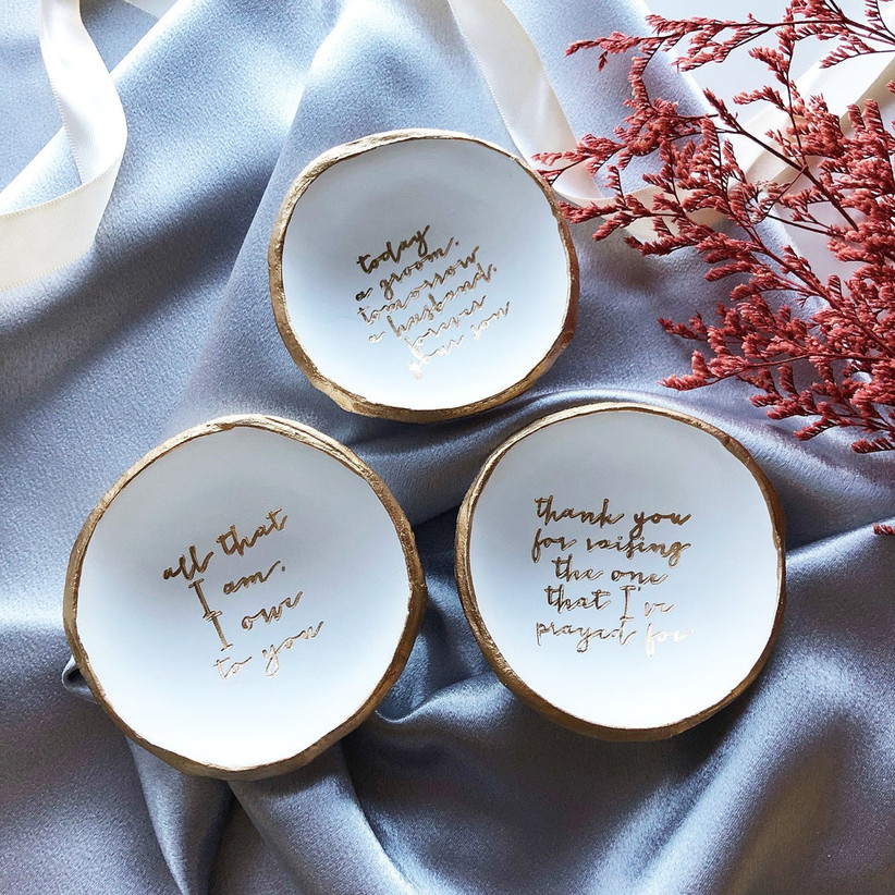 Three white and gold trinket dishes with different heartfelt messages