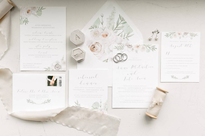 elegant white wedding invitation suite decorated with watercolor rose and greenery design