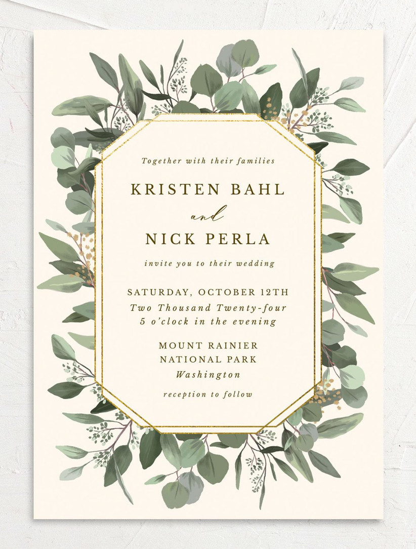 rustic spring wedding invitation with greenery border and gold foil accents