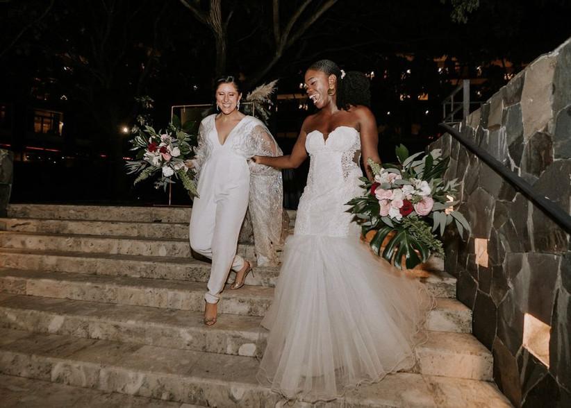 two brides walking down stone steps