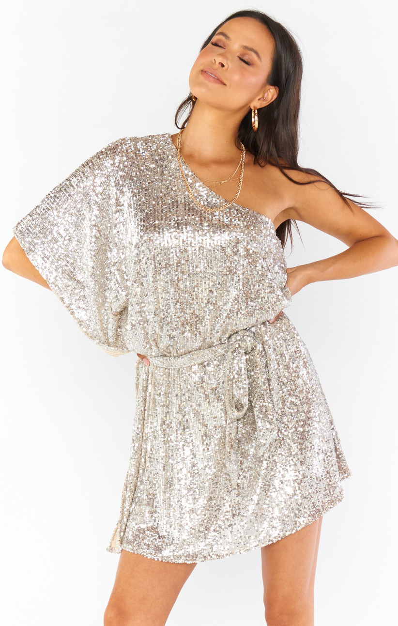 one-shoulder bachelorette party dress with allover gold and silver sequins and adjustable waist tie