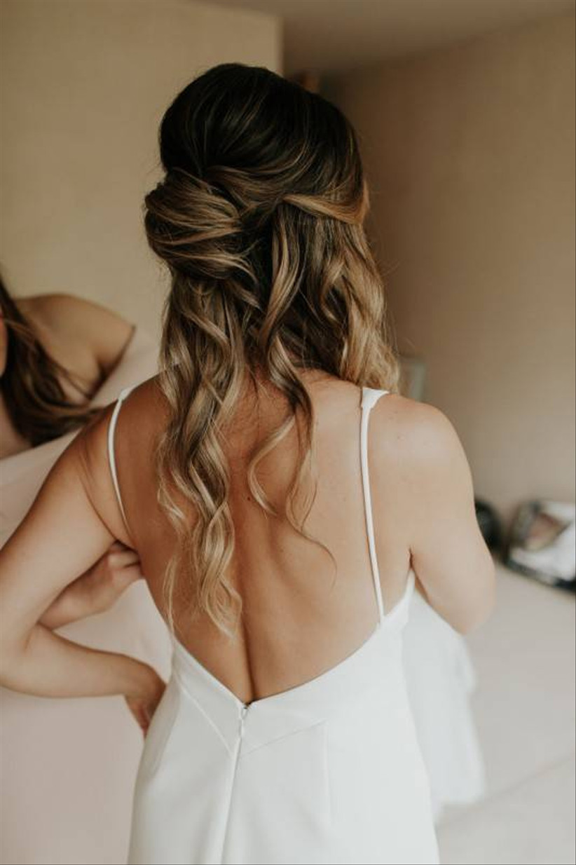 half-up beach wedding hairstyle french twist with ends loose