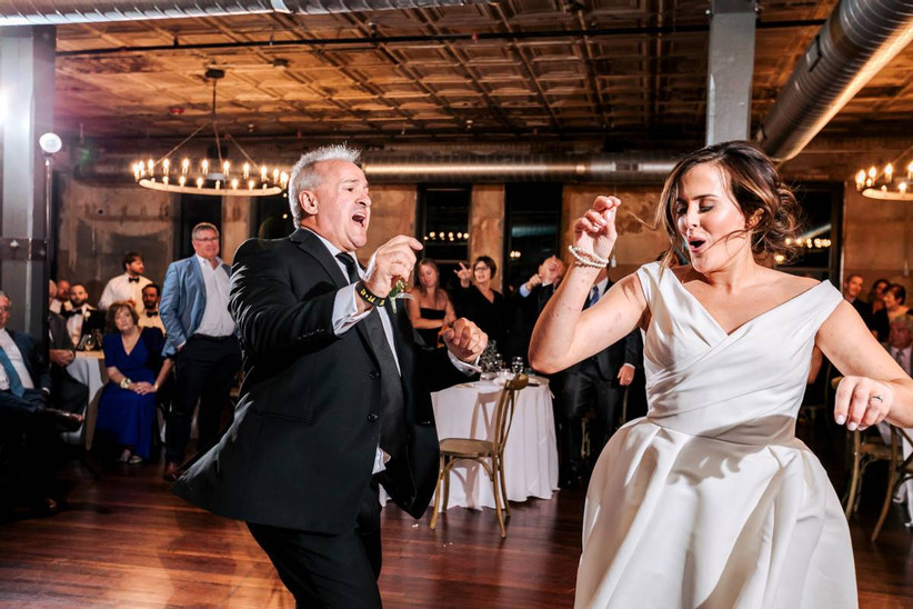 bride and her father dancing and snapping fingers