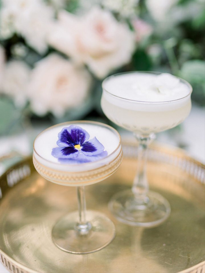 spring wedding idea champagne with pansies on top