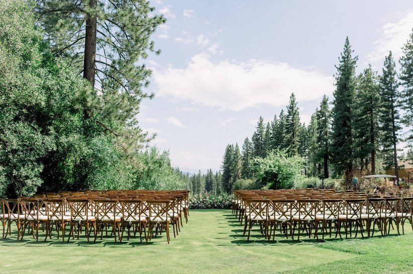outdoor wedding ceremony on a spacious green lawn