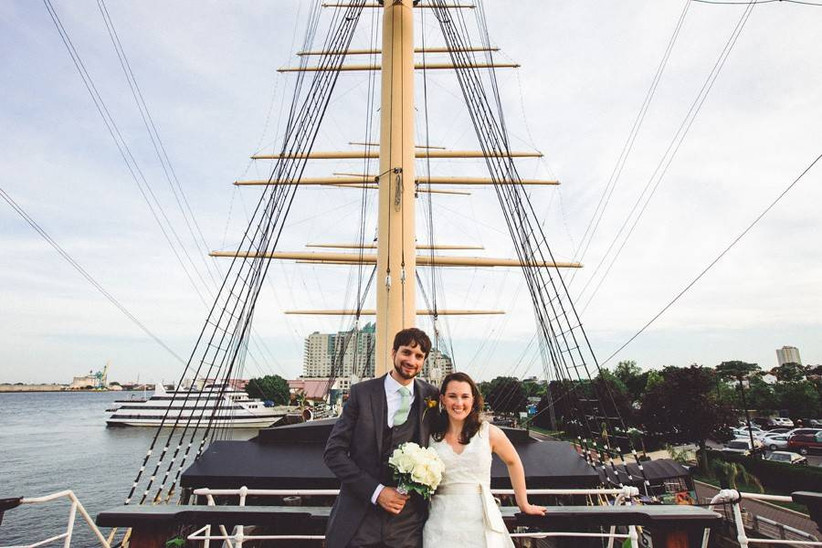 bride and groom posing on boat