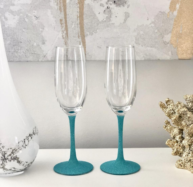 Wedding champagne glasses with colorful glittery stems