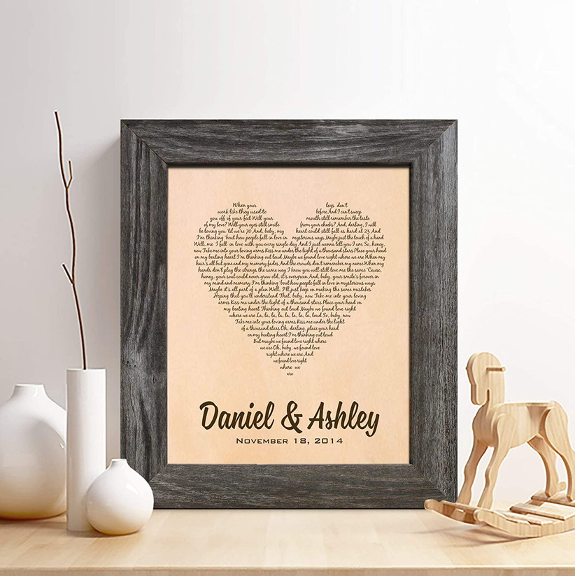 framed leather print with couple's names and song lyrics in the shape of a heart