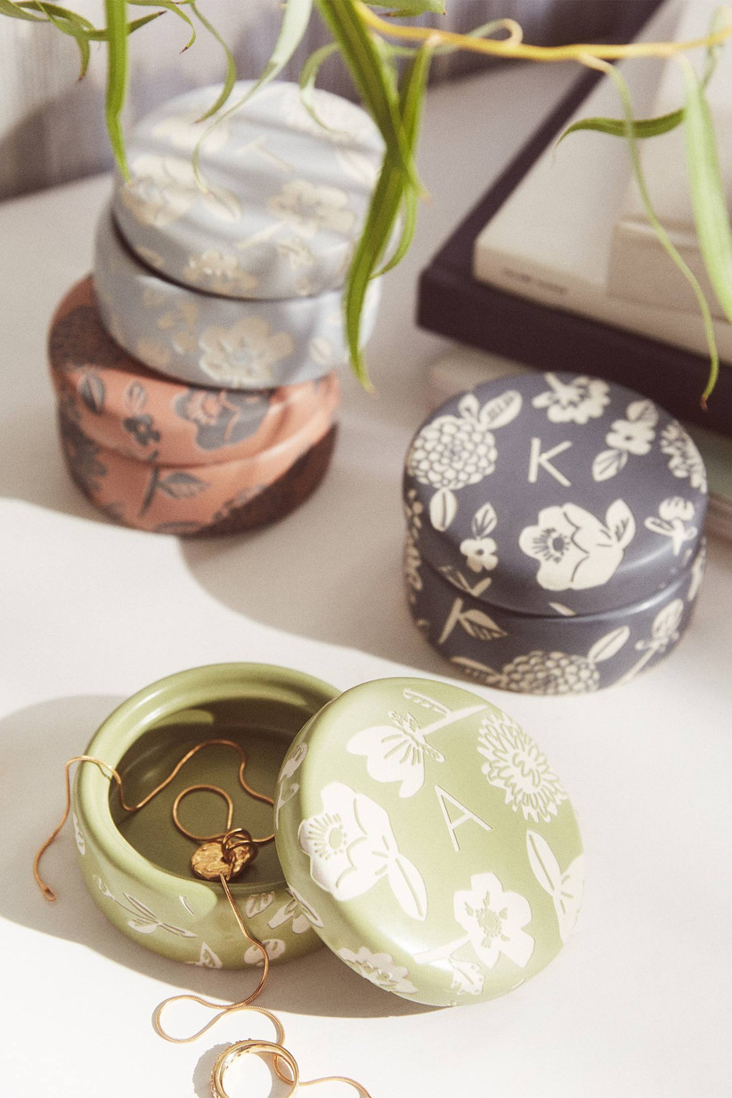 Round trinket boxes with pretty floral pattern and monogram on the lids