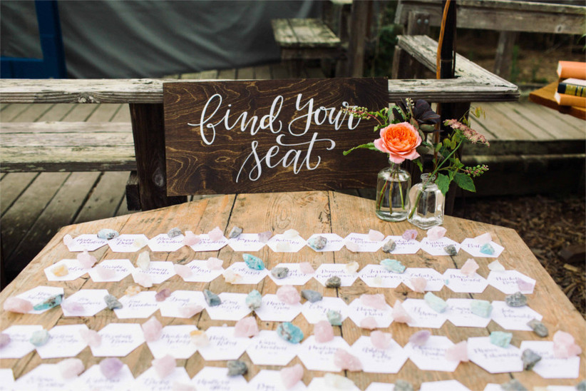 hexagonal escort cards with individual crystals placed on top