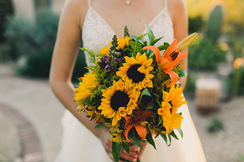 colorful sunflower wedding bouquet with orange tiger lilies, yellow alstroemeria and greenery