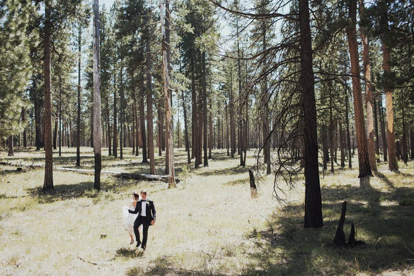 wedding couple walking in the woods