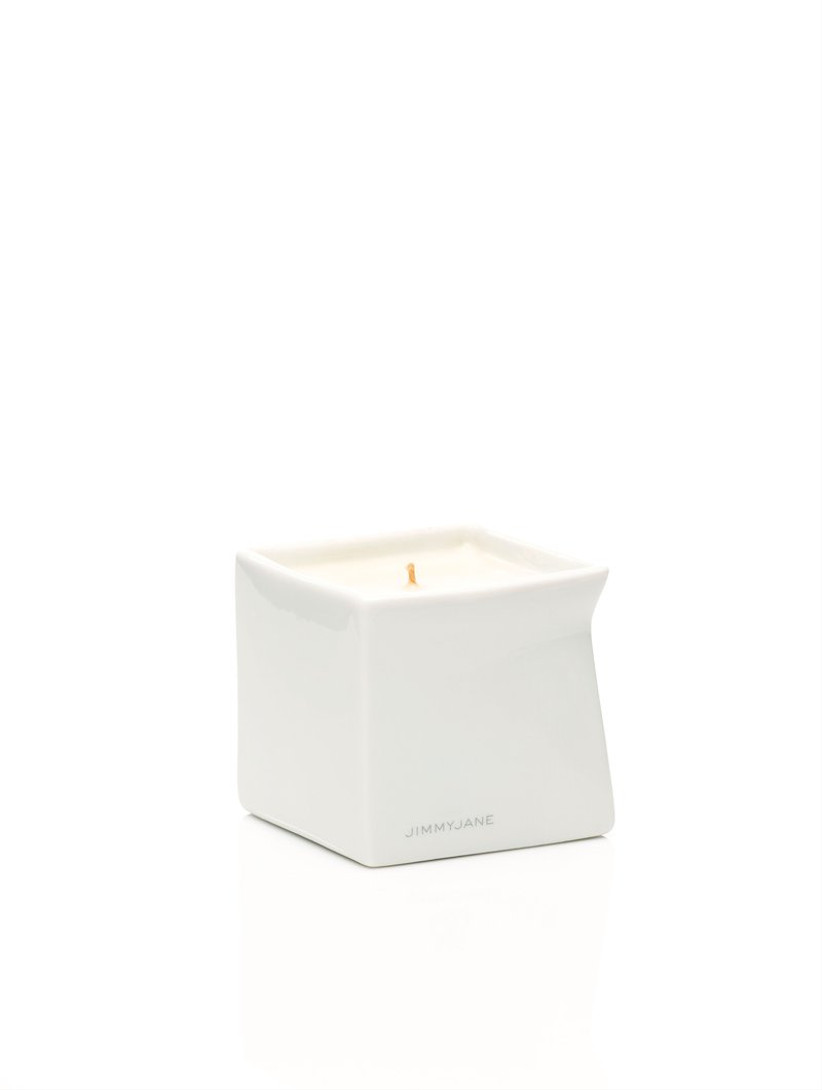 white cube of massage oil candle