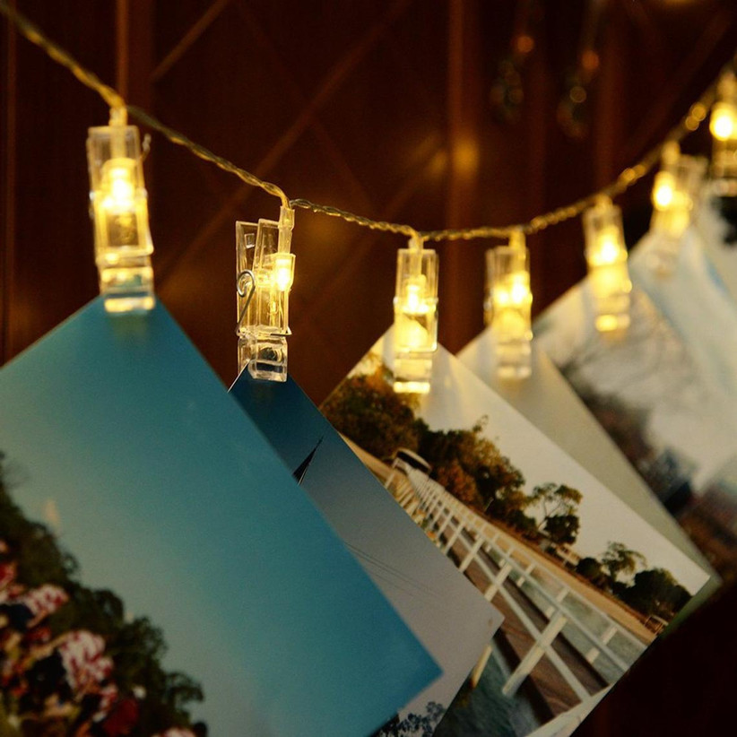 String lights with photo clips engagement party decoration idea