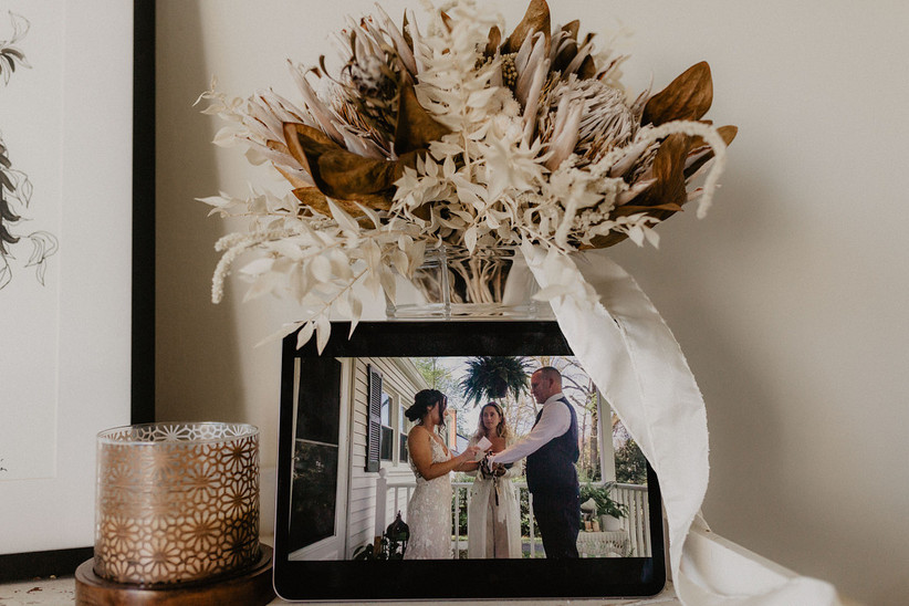 bride and groom exchange vows on a tablet screen