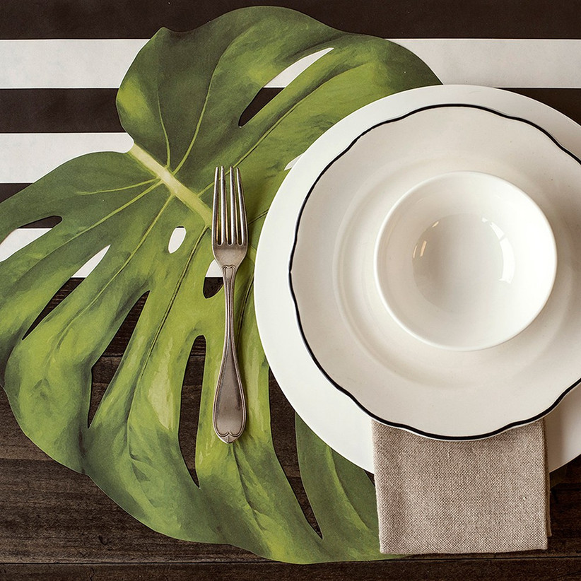 Sophisticated tropical place setting with monstera leaf place mat