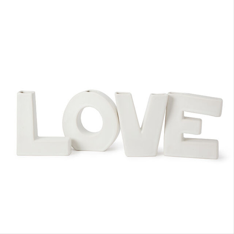white vase in the shape of the word love