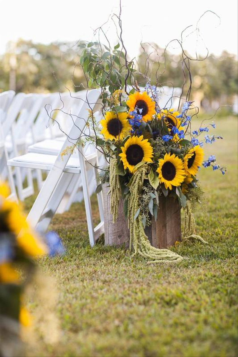 sunflower wedding ceremony decor at the start of the aisle