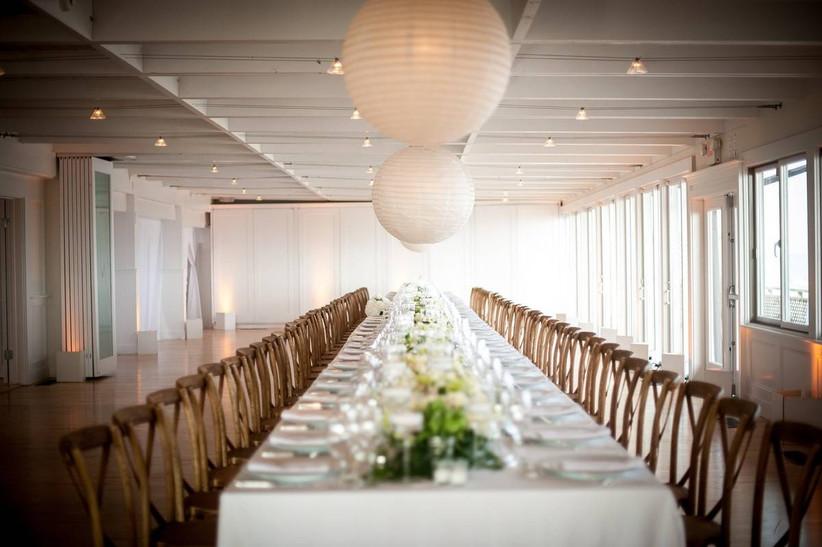 long farm table at indoor wedding reception