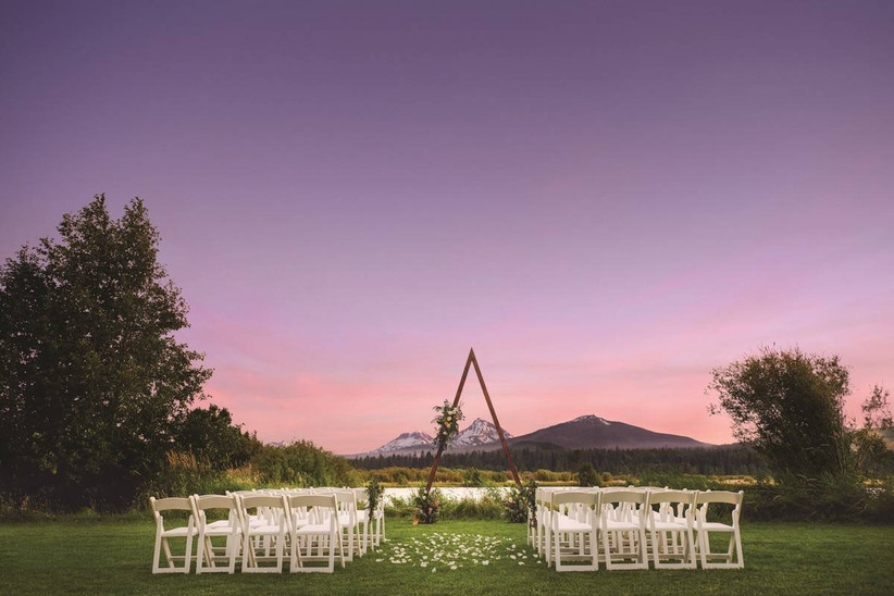 wedding ceremony with tipi ceremony structure
