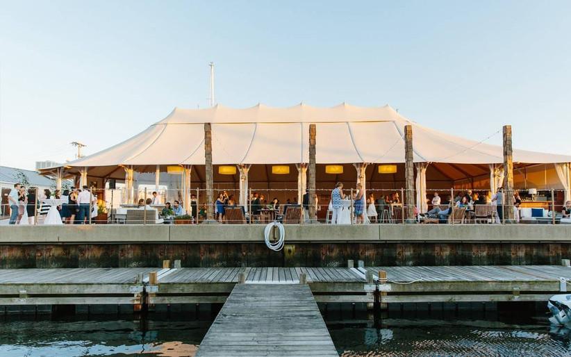 waterfront rhode island wedding venue under a tent along the dock at sailboat marina