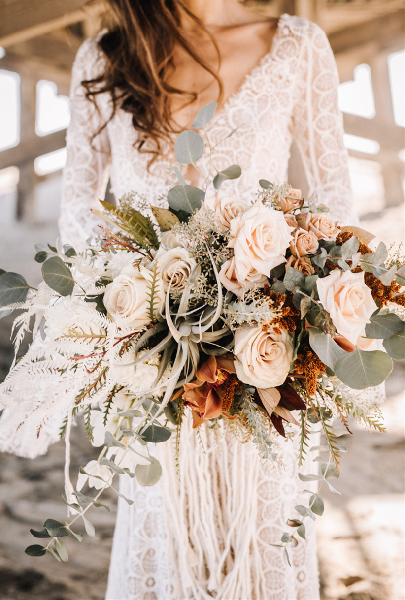 boho beach wedding bouquet with dried greenery and pale pink and white roses
