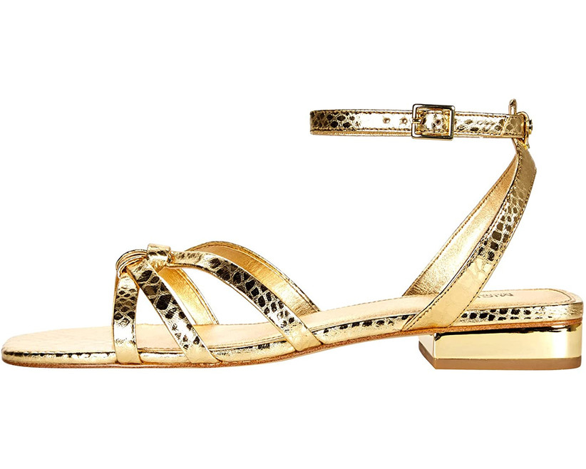 flat metallic gold sandal with snake-print leather and cross-straps