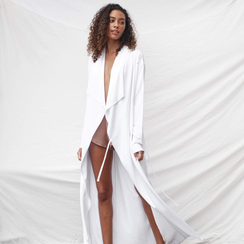 woman wearing pajamas and long white robe