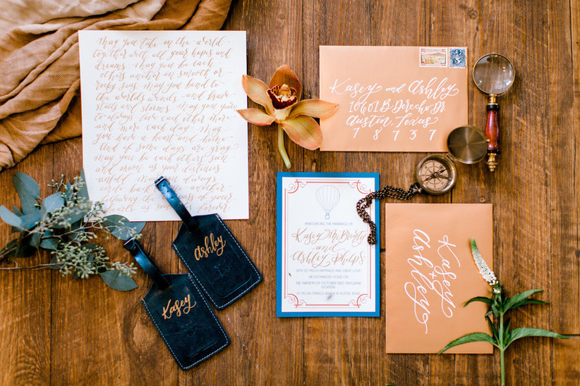 travel themed wedding invitations with compass and hot air balloon motif