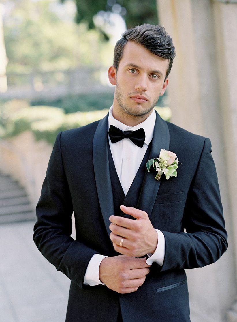 black tuxedo with blush rose wedding boutonniere