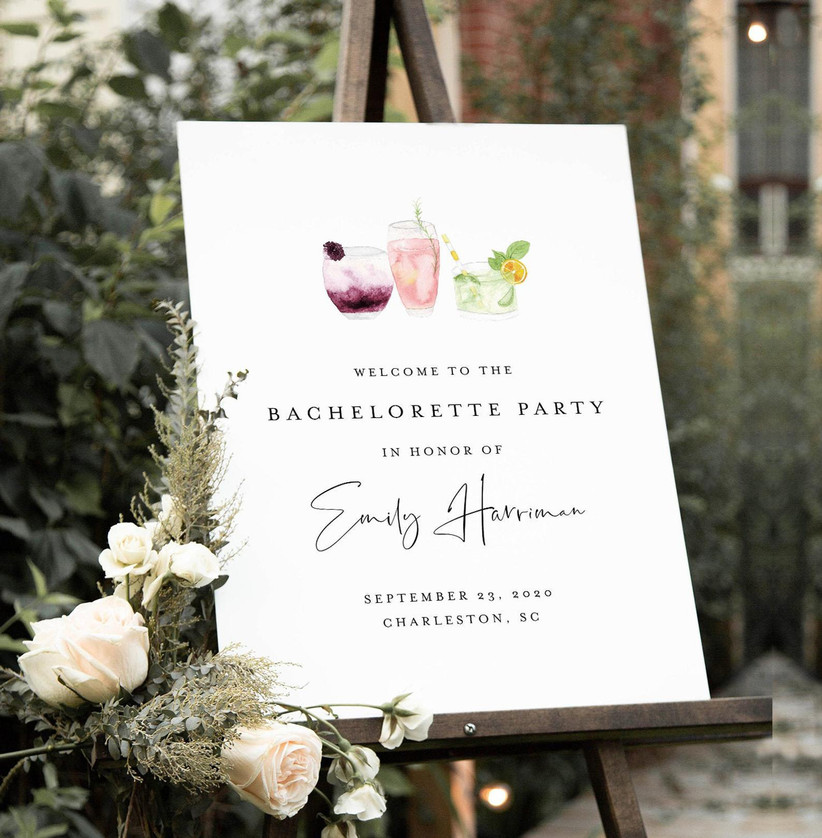 Personalized bachelorette party welcome sign with white background, elegant font, and watercolor illustration of cocktails