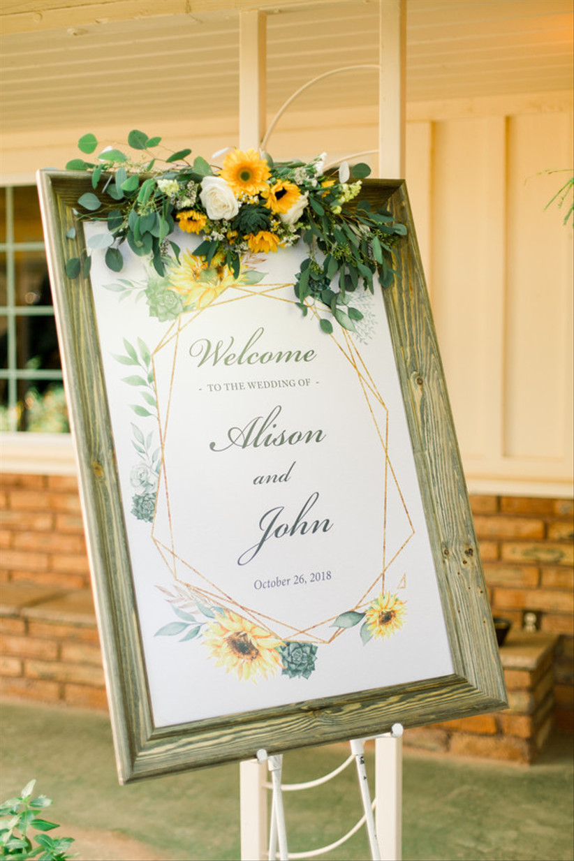 sunflower themed wedding welcome sign in wooden frame