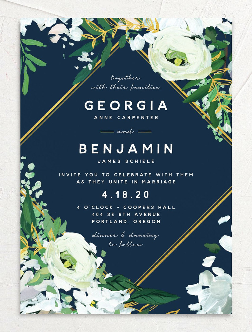 classic summer wedding invitation with navy blue background and white flowers with gold geometric border