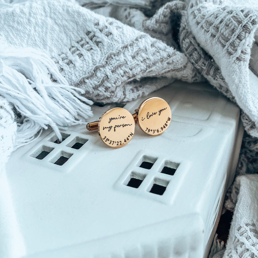 Round copper-toned cuff links with custom coordinates and heartfelt engravings