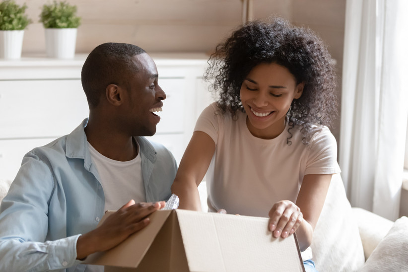 Couple smiling opening a package