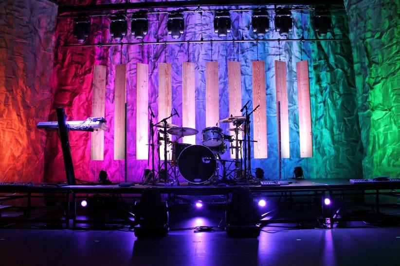 rainbow-colored uplighting at wedding reception