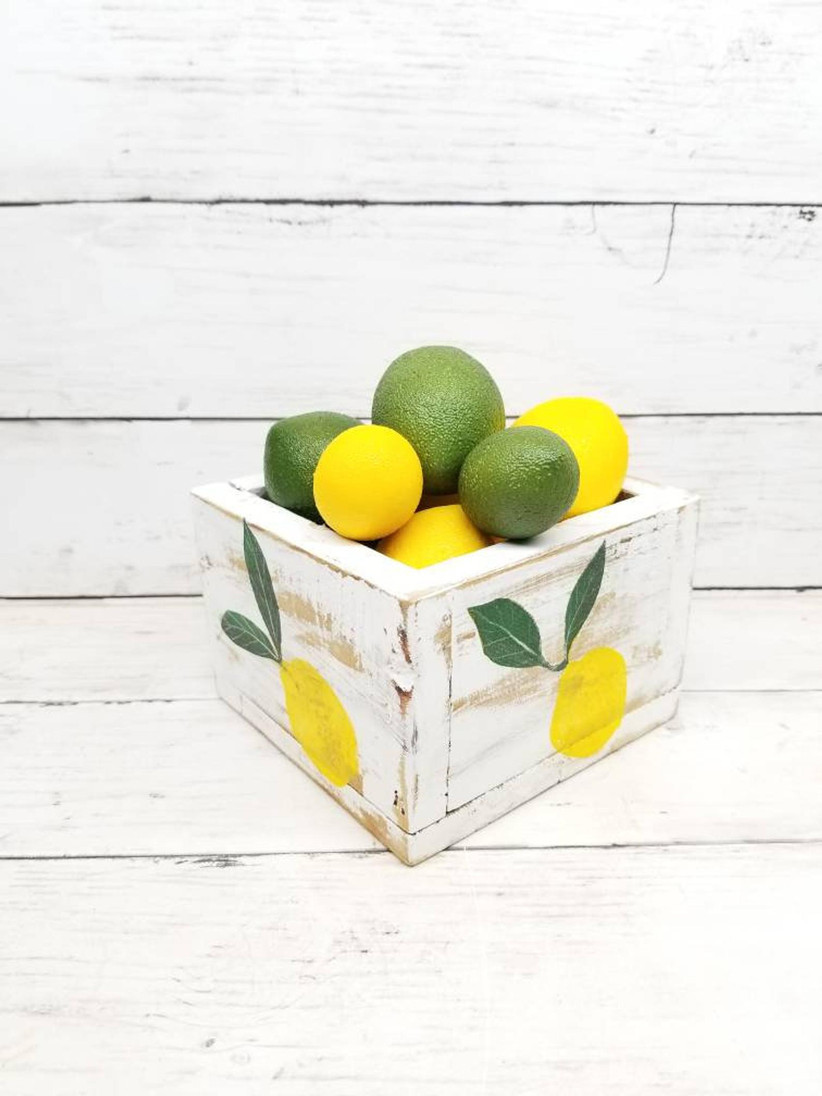 Rustic bridal shower centerpiece planter painted with lemons and filled with lemons and limes
