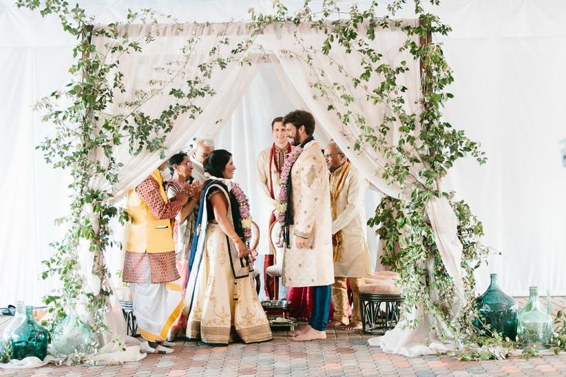 simple wedding mandap with tan fabric and greenery